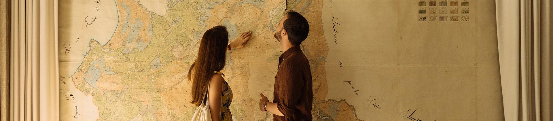 Couple in front of large map by Andri Peetso